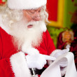 Santa reading a letter — Stock Photo