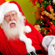 Santa worried about wish list — Stock Photo