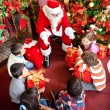 Santa Claus with the kids — Stock Photo