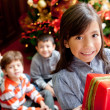 Children with Christmas presents — Stock Photo #8850783