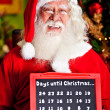 Santa counting the days for Christmas — Stock Photo