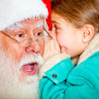 Telling Santa a secret - Stock Photo