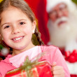 Christmas girl with a gift - Stock Photo