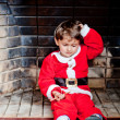 Santa in the chimney - Stock Photo