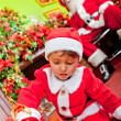 Little Santa with gifts — Stock Photo #8850819