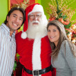 Couple with Santa Claus — Stock Photo