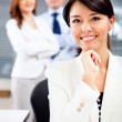 Woman with a business team — Stock Photo #8850868