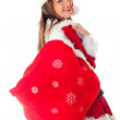 Female Santa with gift sack — Stock Photo