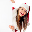 Mrs. Claus with banner — Stock Photo #8850943