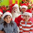 Stock Photo: Group of kids with Santa
