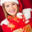 Generous female Santa — Stock Photo