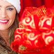 Mrs Claus with Christmas present — Stock Photo #8851021