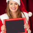 Mrs Claus with blackboard — Stock Photo #8851026