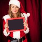Female Santa with a blackboard — Stock Photo #8851029