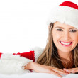 Mrs Claus leaning on a banner — Stock Photo