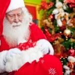 Santa Claus leaving gifts — Stock Photo #8851062