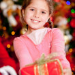 Girl with a Christmas present — Stock Photo #8851065