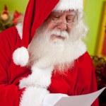 Santa reading a Christmas letter — Stock Photo