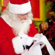 Royalty-Free Stock Photo: Santa reading a Christmas letter