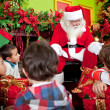 Santa telling a Christmas story — Stock Photo