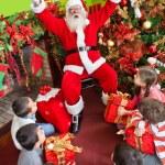 Santa with kids — Stock Photo