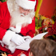 Santa reading to the children — Stock Photo