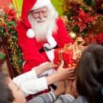 Santa giving presents — Stock Photo