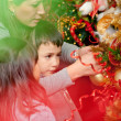 Decorating a Christmas tree — Stock Photo