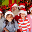 Santa with kids — Stock Photo #8851144