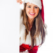 Female Santa with a banner — Stock Photo