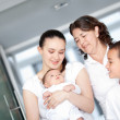 Happy family with a newborn — Stock Photo #8851257