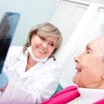 Dentist with an elder patient — Stock Photo