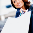 Happy female shopper — Stock Photo #8851480