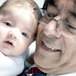 Baby with his pediatrician — Stock Photo