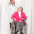 Elder woman in wheelchair - Stock Photo