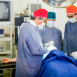 Stock Photo: Doctors in surgery