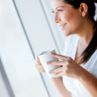 Woman drinking coffee - Stockfoto