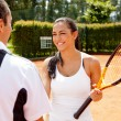 Couple playing tennis - Stock Photo