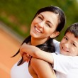 Mother and son at the tennis court - Stock Photo