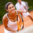 Stock Photo: Couple playing tennis