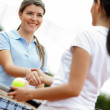 Women playing tennis - Stock Photo