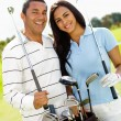 Couple playing golf — Stock Photo #8851859