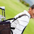 Man with a golf sack — Stok fotoğraf