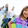 Girl and family playing golf — Stock Photo