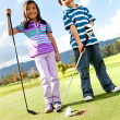 Kids playing golf — Stock Photo #8851873