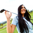 Woman playing golf - Stock Photo