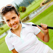 Girl playing golf - Stock Photo