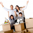 Family excited moving house — Stock Photo