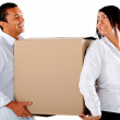 Couple carrying boxes — Stock Photo