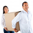 Stock Photo: Couple packing in boxes